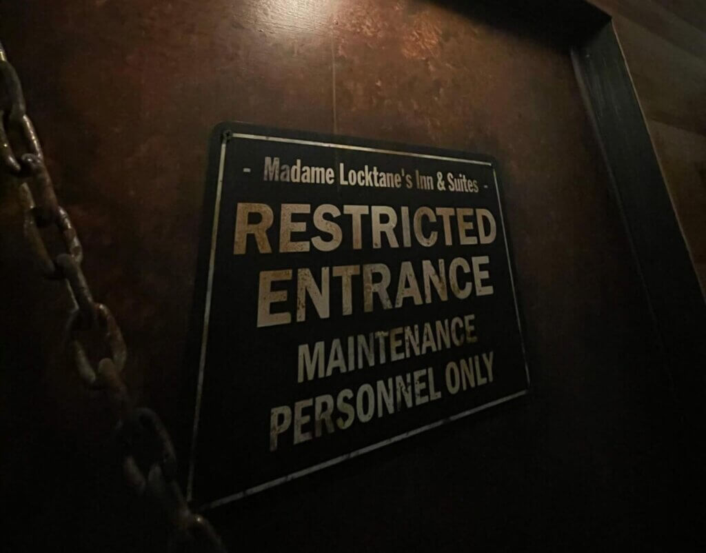 """Closeup of sign saying """"Madame Locktane's Inn & Suites: Restricted Entrance –Maintenance Personnel Only"""""""