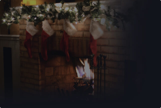 Faded image of Christmas-themed fireplace with stockings